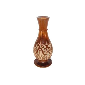 carved traditional vase with brown design