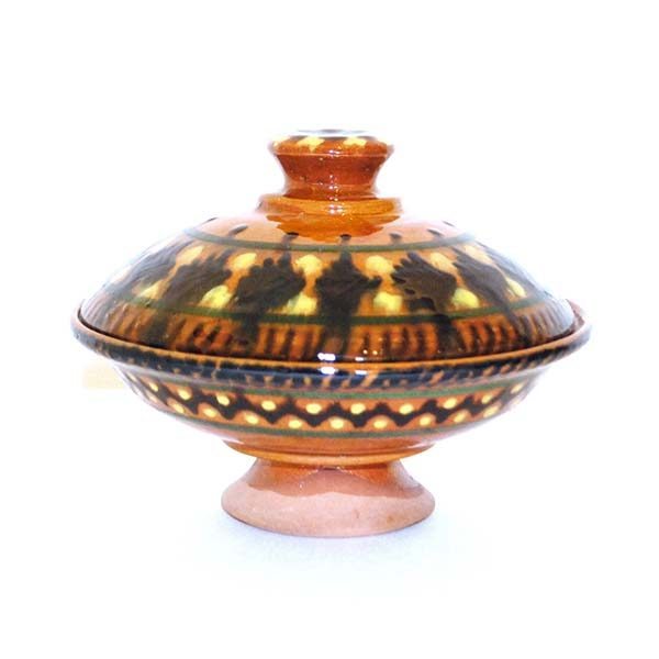 handcrafted ceramic dish with multicoloured design