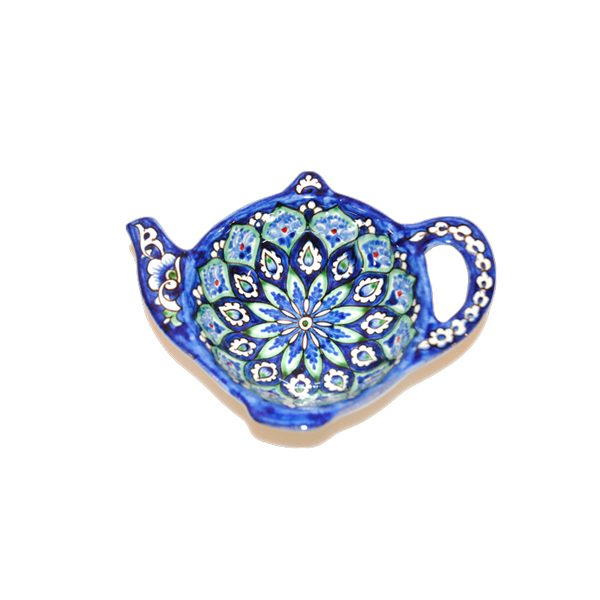 small teapot shaped plate with multicoloured design