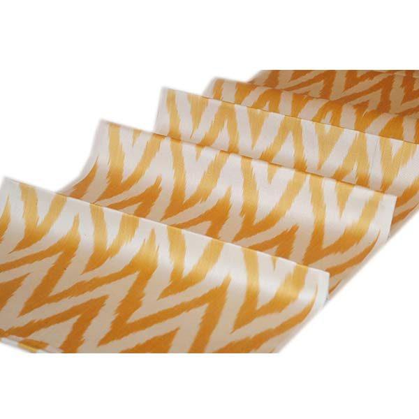 rich handwoven fabric with unique golden zigzag design