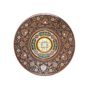 large carved wooden plate with colourful design