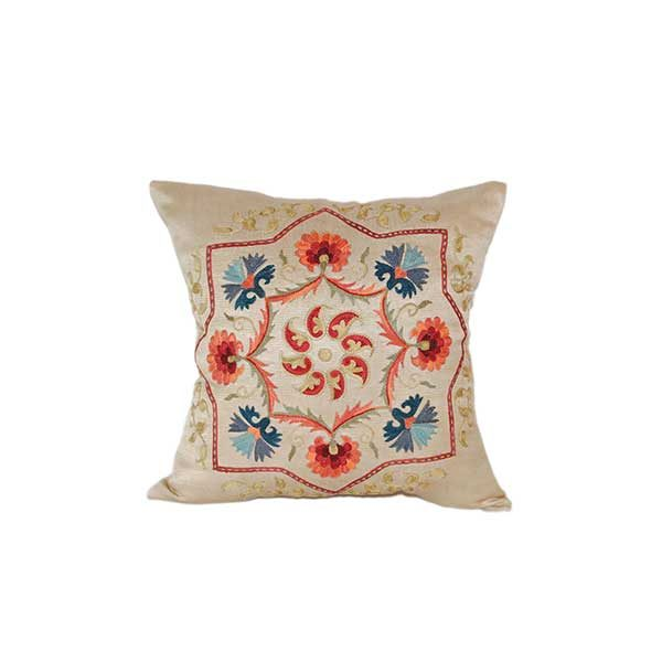 handwoven cushion with colourful design